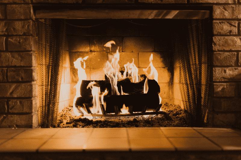 Advanced Fireplace Technician roaring fire in fireplace